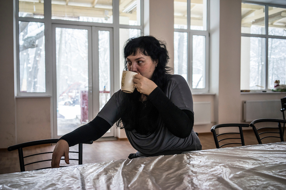 Natasha Kaporina, 37, at Romashka, a summer camp where she and several hundred other people live after being displaced by fighting in Eastern Ukraine on Friday, February 13, 2015 in Kharkiv, Ukraine.