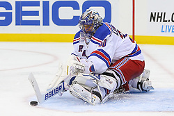Oct 21, 2014; Newark, NJ, USA; New York Rangers goalie Henrik Lundqvist (30) makes a save during the second period of their game against the New Jersey Devils at Prudential Center.