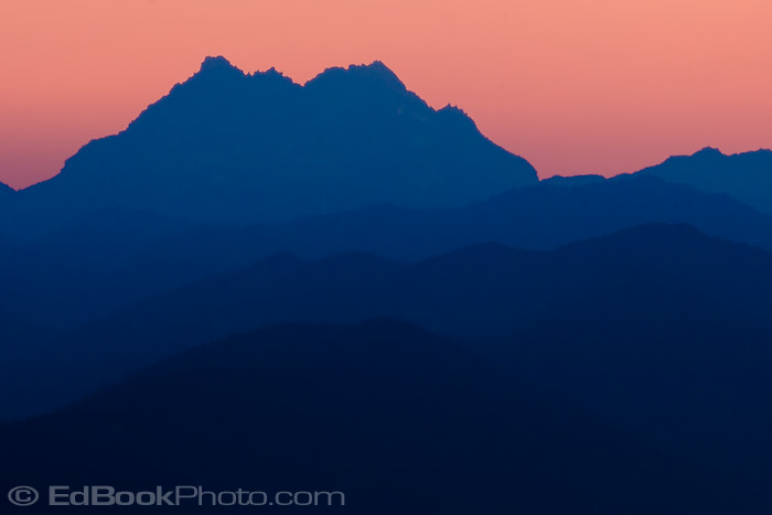 Evening shilouette of The Brothers, a mountain in the Olympic Mountains as viewed from the Kitsap Peninsula in Puget Sound, Washington, USA
