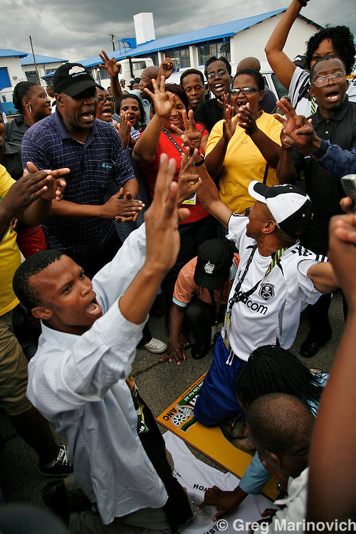 """POLOKWANE, SOUTH AFRICA DEC 15, 2007: Supporters of the South African President Thabo Mbeki make a hand sign meaning """"third term"""" ahead of the ANC confreence in Polokwane, Limpopo province, South Africa at registration of delegates. Photo Greg Marinovich / Bloomberg News"""