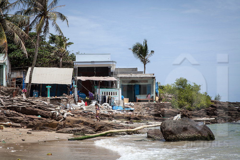 Very modest houses are built on the beach front in An Thoi, south of Phu Quoc Island, Vietnam, Asia 2012