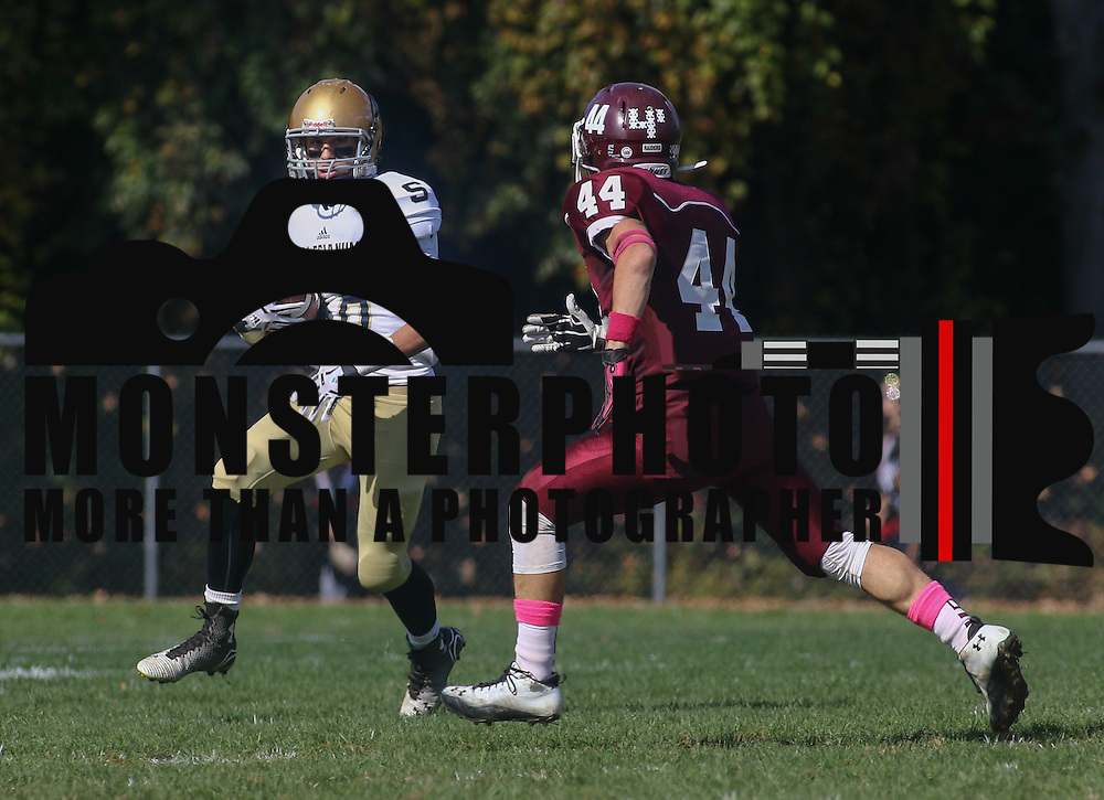 Salesianum running back Nicholas	Merlino (18) attempts to gain extra yards after catch in the second quarter Saturday, Oct. 17, 2015 at Concord Stadium in Wilmington.