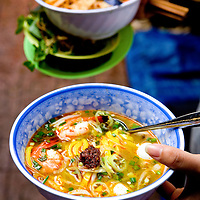 noodle delivery, saigon, vietnam. noodle dishes like this are usually served with a compliment of herbs and fresh greens on the side.
