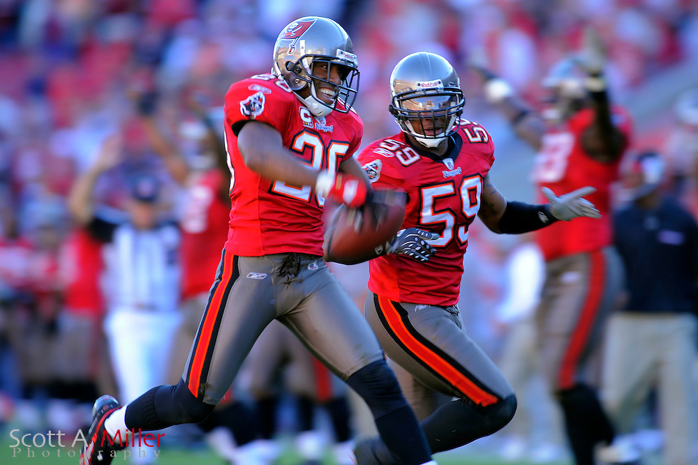 Nov. 16, 2008; Tampa, FL, USA; Tampa Bay Buccaneers cornerback Ronde Barber (20) and linebacker Cato June (59) during the Bucs game against the Minnesota Vikings at Raymond James Stadium. The Bucs won 19-13. ...©2008 Scott A. Miller