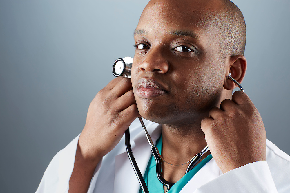 A portrait series representing the intense emotions that Doctors face.  A African American male Doctor wearing a white lab coat, stethoscope, and green medical scrub suit shown.