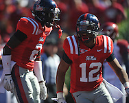 Ole Miss' Donte Moncrief (12) celebrates his second quarter touchdown reception with Ole Miss' Nickolas Brassell (2) vs. Arkansas at Vaught-Hemingway Stadium in Oxford, Miss. on Saturday, October 22, 2011. .
