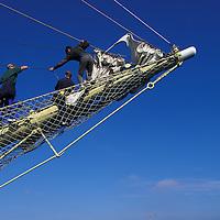 Europe, Norway, Stavanger, Young sailors work on the Navy training ship Sørlandet .