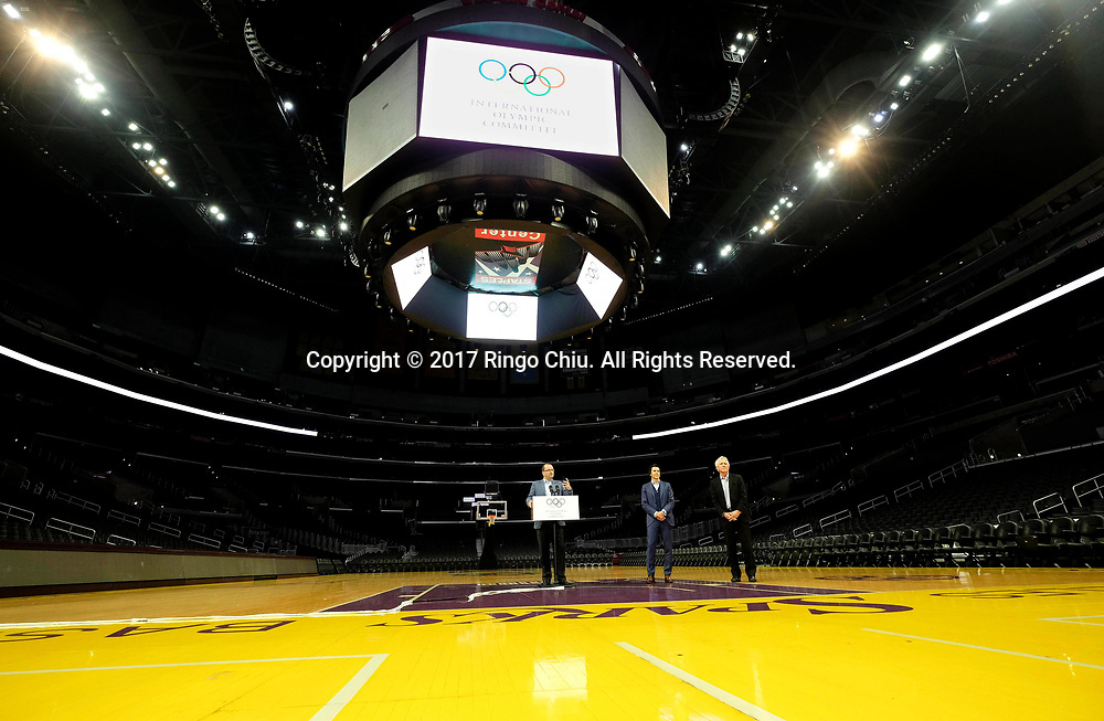 International Olympic Committee Evaluation Commission Chair Patrick Baumann, left, speaks in a news conference at Staples Center, Friday, May 12, 2017, in Los Angeles, the United States. A team of International Olympic Committee delegates wrap up their a three-day tour of Los Angeles as the city attempts to demonstrate its readiness to stage the 2024 Olympics.<br />   (Xinhua/Zhao Hanrong)(Photo by Ringo Chiu/PHOTOFORMULA.com)<br /> <br /> Usage Notes: This content is intended for editorial use only. For other uses, additional clearances may be required.
