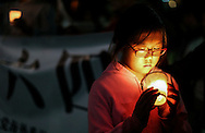 A young protestor holds a candle during a candlelight vigil for the 26th anniversary of June 4 Tiananmen Square Massacre in Beijing, at outside of The Consulate General of the PRC on June 4, 2015 in Los Angeles.