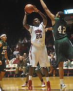 "Ole Miss guard Nick Williams (20) shoots over Mississippi Valley State's Jason Holmes (42) at C.M. ""Tad"" Smith Coliseum in Oxford, Miss. on Monday, December 13, 2010."