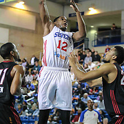Delaware 87ers Forward Ronald Roberts (12) attempts a short range shot as Sioux Falls Skyforce Guard Chris Allen (11) and Sioux Falls Skyforce Forward Shawn Jones (22) defends in the first half of a NBA D-league regular season basketball game between the Delaware 87ers (76ers) and the Sioux Falls Skyforce (Miami Heat) Tuesday, Dec. 2, 2014 at The Bob Carpenter Sports Convocation Center in Newark, DEL
