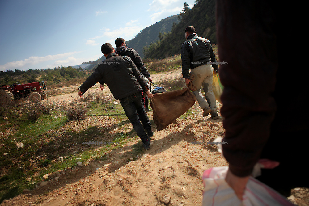 Smugglers carry a load of rifles to Al Janoudiyah, Province of Idlib, Syria.