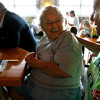 ANNA MARIA ISLAND, FL -- July 9, 2009 -- Duffy's Tavern owner Pat Geyer shares a laugh with longtime friend and customer, Liz Christie-Cline, right, on Anna Maria Island in Manatee County, Fla., on Thursday, July 9, 2009.  (Chip Litherland for The New York Times)