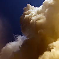 Stormy puffy massiv cloud in dark sky, irish weather / cl035