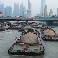 Barges full of sand waiting in Suzhou creek, Shanghai.