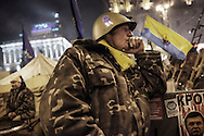 A moody protester stands  on the watch at one of the barricade blocking  Independance Square the day  after it was announced that Ukrainian President Viktor Yanukovych agreed to receive major economic assistance from Russia, on December 18, 2013 in Kiev, Ukraine. Thousands of protesters have taken to the streets since Ukrainian president Viktor Yanukovych announced a decision to suspend a trade and partnership agreement with the European Union and raised concerns that the nation could be poised to enter a customs union with Russia.