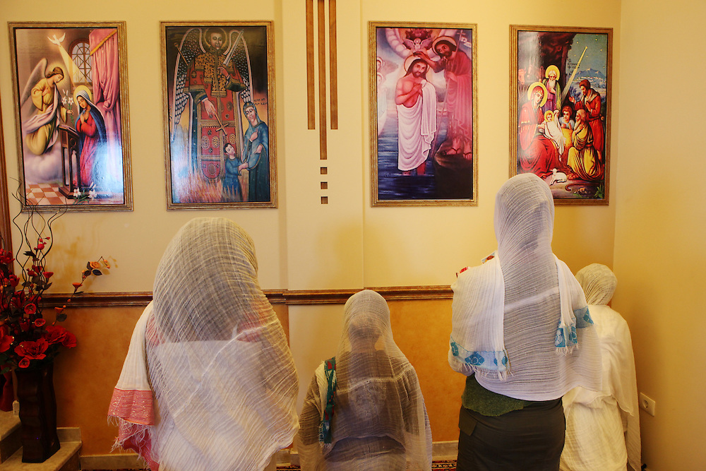 Dressed in traditional white scarves Ethiopian women pray at an Orthodox Church on Easter Sunday.