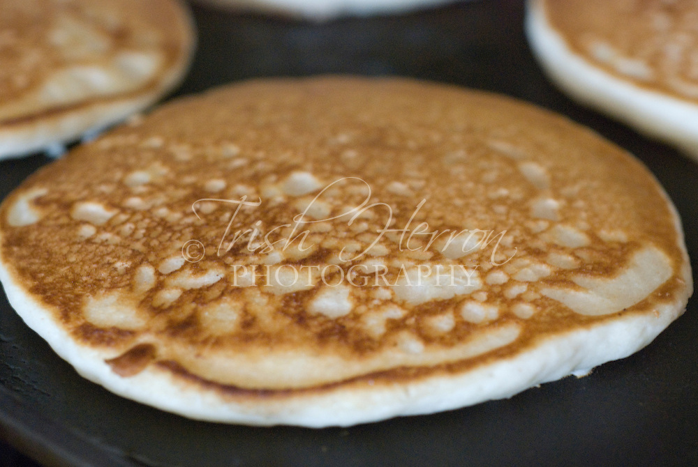 Pancakes cook on a griddle