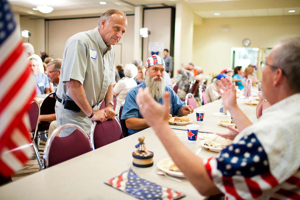 Rep. Steve King (R-IA), left, talks with attendees at a Calhoun County Republican Party dinner before a campaign appearance by Republican presidential candidate Rep. Michele Bachmann (R-MN) on Monday, August 8, 2011 in Rockwell City, IA.