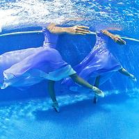 Ballerinas dancing underwater in a swimming pool.MR. Model relased photo.