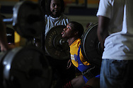 Tias Hilliard squats during Class 5A Region weightlifting competition at Oxford High School in Oxford, Miss. on Saturday, February 9, 2013.