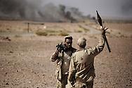 LIBYAN ARAB JAMAHIRIYA: Libyan rebel fighters in Um al Far after they took control of the village, on July 28, 2011. ALESSIO ROMENZI