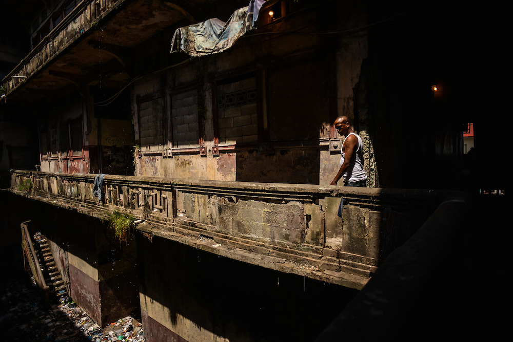 The Wilcox building, which was once an architectural landmark in Colón, is now a condemned building, notorious for being a violent crime hub in the city, with over 100 squatters living inside. An area that was once a courtyard is now filled with garbage and run off sewage.  Despite being the second largest city in Panama, Colón is one of the poorest in the region, and its residents suffer from a critical shortage of potable water, sewer connections and housing--many people live in condemned or should be condemned buildings. Panama is now one of the fastest growing countries in Latin America and there is a growing resentment and impatience that Colón has not reaped as much of the benefit as Panama City.
