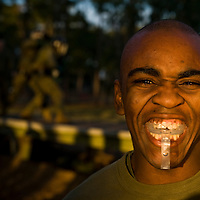 Private First Class Mercedes Malcom shows off his mouth gaurd at Parris Island, S.C., on Nov. 24, 2007. (Photo by Stacy L. Pearsall)