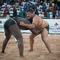 02/07/2012. Senegal, Dakar. One day with the White Lion.    The canarian wrestler Juan Espino, the unique white fighter in the senegalese wrestling. Despite the blow received at the beginning of the battle, The White Lion will have no trouble to knock his opponent Keur Dième . ©Sylvain Cherkaoui