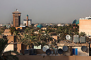Satellite dishes are seen on atop apartment blocks in downtown Baghdad August 26, 2010.  Under Saddam Hussein's rule of the country satellite dishes were illegal. After the fall of Baghdad to U.S. Forces in 2003, Iraqis quickly embraced dishes, cell phones and the internet, all of which they had been denied for so long.  .