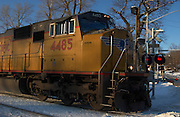 Ames,Iowa,USA Snowy and cold,crisp and clear with blue sky,locomotive engine