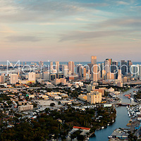 Wide aerial panorama of The Miami skyline from the west with the Miami River and Dolphin Expressway in the foregound