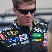 Carl Edwards smiles for the carmers prior to the start of the 42 Annual Sprint Cup Series Sunday, Oct. 02, 2011 at Dover International Speedway in Dover Delaware.
