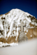 """SHOT 3/16/10 5:07:06 PM - A headstone peeks out from beneath some deep snow at the Crested Butte Cemetery in Crested Butte, Co. The Crested Butte Cemetery was established in 1879 and is located about 1/2 mile northeast of the town of Crested Butte. The cemetery is located in a spectacular setting with the rugged beauty of Mt. Crested Butte as a backdrop. The cemetery is a great place to get a sense of the history of the area and many graves are those of miners from the early days of Crested Butte. Crested Butte is a Home Rule Municipality in Gunnison County, Colorado, United States. A former coal mining town now called """"the last great Colorado ski town"""", Crested Butte is a destination for skiing, mountain biking, and a variety of other outdoor activities. .(Photo by Marc Piscotty / © 2010)"""
