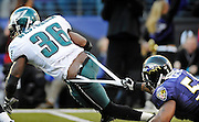 Ravens linebacker Antwan Barnes (50) stops Eagles running back Brian Westbrook (36) by the seat of his pants, relatively, for a two-yard loss in the third quarter of their games. The Ravens beat the Eagles 36-7 at M&T Bank Stadium.