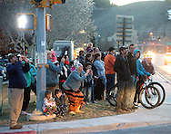 A crowd gathers Thursday evening on Broadway, watching as the hillside cracks with frequent rockfall as the landslide moves down East Gros Ventre Butte.