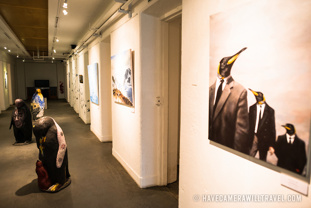 Various artworks depicting penguins on display in the Art Gallery at the the Police and Penitentiary Museum that forms one part of the Maritime Museum of Ushuaia. The museum is housed in the city's old prison.