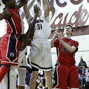 Concord Raiders Forward Joseph McHugh (31) pulls down the offensive rebound as Plymouth Whitemarsh Guard Andre Mitchell (32) defends in the first half of a regular season non-conference high school basketball game between the Plymouth Whitemarsh Colonials and Concord High Raiders Monday, Jan. 19, 2015 at Concord High School in Wilmington, DEL