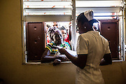 The pharmacy at the clinic is a place of chaos. Patients wait outside to pass their perscriptions through the open window to someone on the inside who can process and fill them. Wait times vary depending on how busy the clinic is. The pharmacy is a simple room located at the far end of the clinic with one table and one set of shelves that hold the medicine and allow for the pharmasict to do her work.