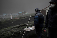 Environmental engineers from Reykjavik University visit a farm in rural area under the plume to monitor the consequence of a thick fall of the fallout from Iceland's Eyjafjoell volcano. They also scoop samples of ashes for study. Darkness settles under an ash cloud  spewed by Iceland's Eyjafjallajokull volcano that blacked out visibility under the plume. Picture taken in full day light during the afternoon.13 May 2010.<br /> &copy;  Etienne de Malglaive.