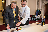 Sen. Charles Schumer, left, and executive chef Shannon Shaffer demonstrate hickory grilled bison with red potato horseradish cake and huckleberry reduction, which will be served for the inaugural lunch, on Friday, January 4, 2013 in Washington, DC.