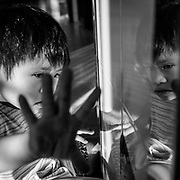 August is Agent Orange Awareness month, and as such, I&rsquo;d like to share a few images from my ongoing project &ldquo;I Am Now: Dioxin&rsquo;s Legacy in Vietnam&rdquo; over the next few weeks<br /> <br /> While most associate the now infamous term with the war in Vietnam that ended over 40 years ago, few probably realize that the lasting effects of the chemical still continue today. Being deeply entrenched in the soil and water in parts of Vietnam, Dioxin makes its way into pregnant mothers and their children, both far removed from any fighting. Many have been born in the previous decades in with physical and mental birth defects, and in fact, children bearing the burdens of this horrible substance still continue to be born today. <br /> <br /> In this image, Na, 7, a resident of Peace Village, a small hospital ward in Ho Chi Minh City that cares for Dioxin affected children, plays with her reflection on the wall. She&rsquo;s always a happy girl, active if not a bit naughty at times. She&rsquo;s one of the luckier ones, without major physical effects, and with the ability to move around and be somewhat independent. My wife and I visit the children here nearly every week, and love every minute we spend with them. <br /> <br /> With these images and during this month, please take a second to reflect on what this manmade chemical has done, and let&rsquo;s make sure such a catastrophe is never allowed to transpire again. Image by @quinnryanmattingly