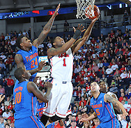 "Mississippi's Martavious Newby (1) shoots against Florida's Casey Prather (24) as Florida's Dorian Finney-Smith (10), Florida's Scottie Wilbekin (5), and Mississippi's Dwight Coleby (23) move in at the C.M. ""Tad"" Smith Coliseum in Oxford, Miss. on Saturday, February 22, 2014. (AP Photo/Oxford Eagle, Bruce Newman)"