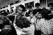 Aitarak Militia members mourn the death of Placidio Ximenes at the Tropical Hotel, Dili East Timor 1999 Ximenes was killed during a clash between Pro-autonomy Militia and Pro-Independence supporters.