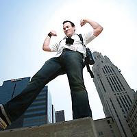 "Matt Barnes in his ""office"" high above the city.(Jodi Miller/Alive)"