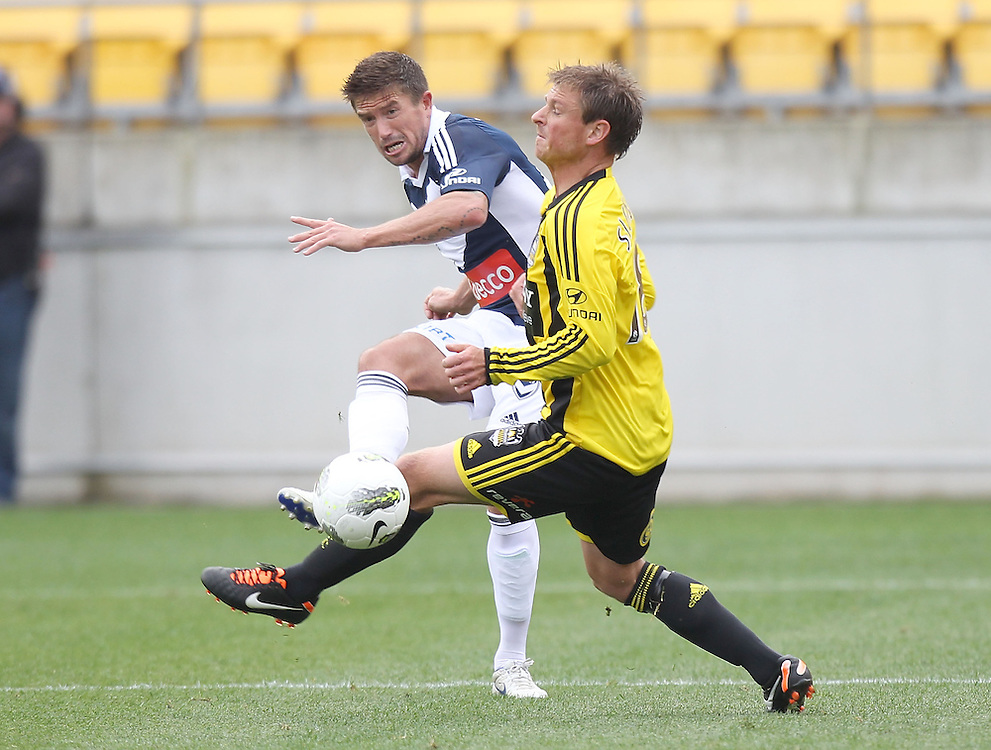 Danny Allsopp of the Victory gets a pass away as he is tackled by Ben Sigmund of the Phoenix in the A-League football match at Westpac Stadium, Wellington, New Zealand, Sunday, October 30, 2011. Credit: SNPA / Marty Melville
