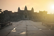 Tourists enter the mysterious Angkor Wat temple at sunrise in Siem Reap, Cambodia.