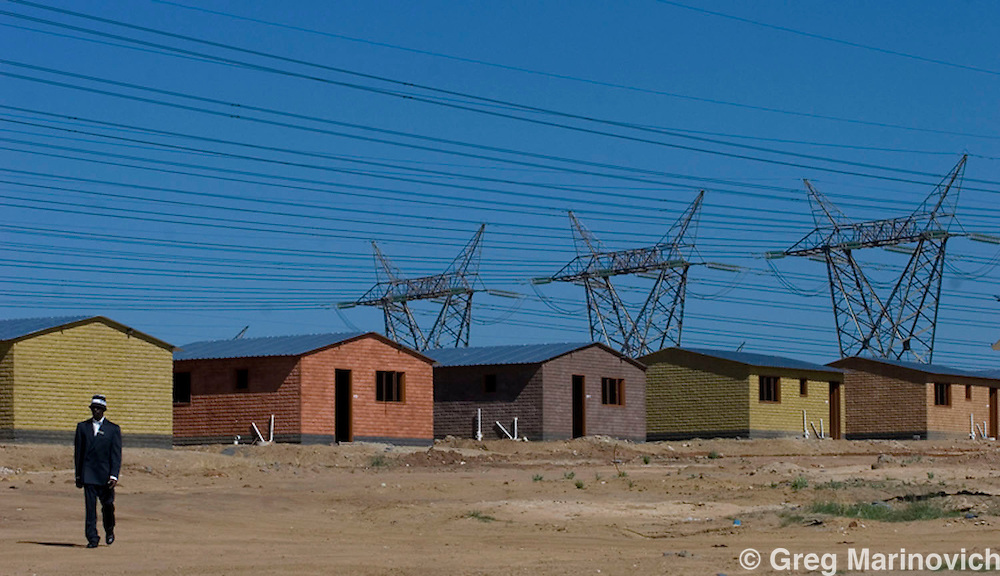 Powerlines from the Minerva sub station in Midrand, Johannesburg, passes over the new government sponsored low income housing estate at Olievenhoutsbosch, between Johaannesburg and Pretoria, South Africa, Nov 4, 2007   Photo Greg Marinovich / Bloomberg News