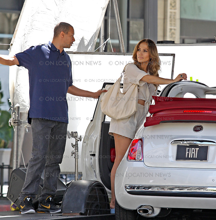 """August 21st 2011 Los Angeles, CA. Non-Exclusive. Jennifer Lopez films a funny music video for her song """"Papi"""". JLo filmed several scenes walking down the street and driving away in a Fiat. In every scene there were crowds of Men who were smitten by beautiful JLo. As she walked down the street some men driving cars crash while other men repel down buildings while others jump out of a moving bus all fighting to get to her. As Jlo gets to her Fiat and drives away a massive crowd of men run after her, some bearing flowers and gifts. Photo by Eric Ford / On Location News 818-613-3955 info@onlocationnews.com"""