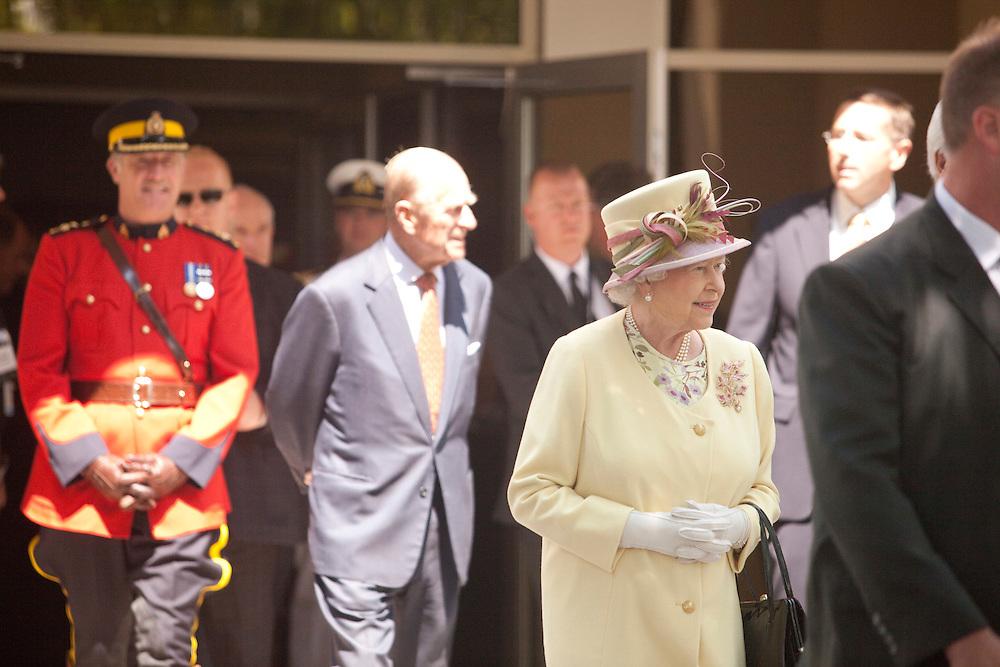 Queen Elizabeth II and Prince Philip, following a tour of the RIM facilities in Waterloo, Ontario, July 5, 2010.<br /> AFP/GEOFF ROBINS/STR